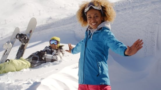 Thumbnail for Successful Female Skier Next To Man In Snow