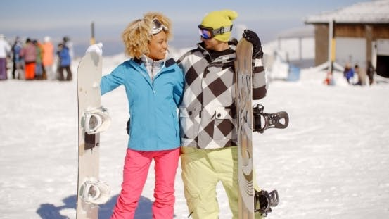 Thumbnail for Loving Young Couple With Their Snowboards