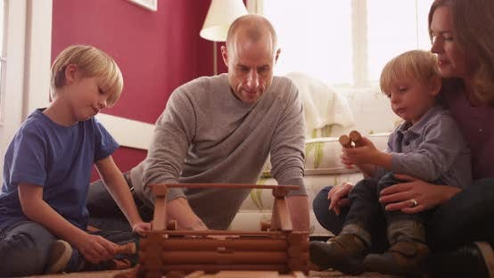 Thumbnail for Kids playing with parents at home