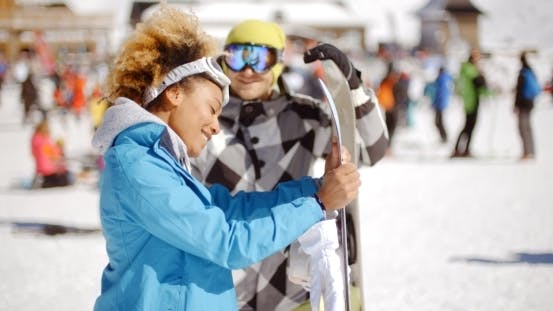 Thumbnail for Man Flirting With Woman Holding Snowboard