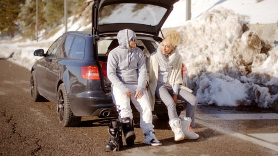 Thumbnail for Couple Talking As They Put On Skiing Boots