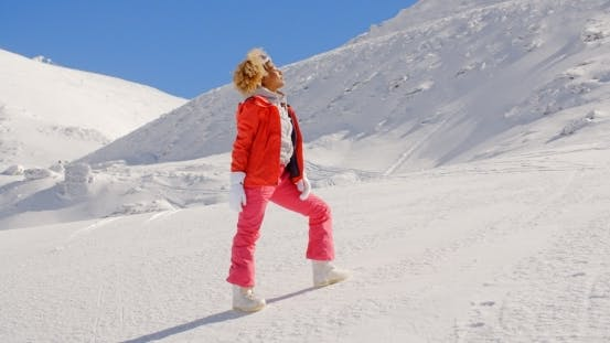 Thumbnail for Beautiful Girl In Ski Outfit On The Snow