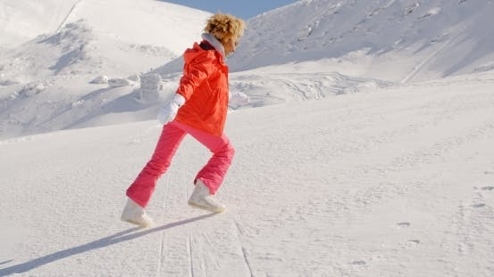 Thumbnail for Person In Snowsuit Running Up Mountain