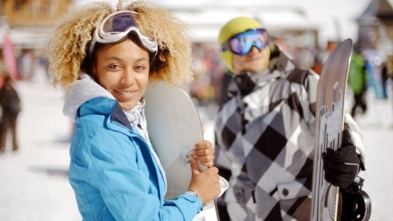 Cover Image for Cute Woman Holding Snowboard On Ski Slope