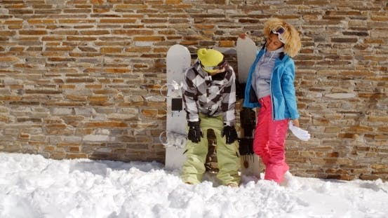 Thumbnail for Snowboarder With Happy Friend In Front Of Wall