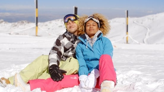 Thumbnail for Couple Sitting In Snow On Ski Slope