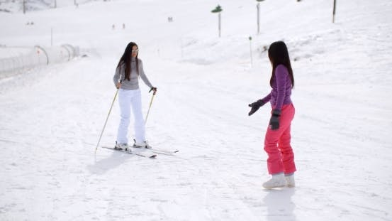 Thumbnail for Young Woman Learning To Ski From a Friend