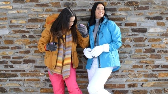 Thumbnail for Cute Twins In Winter Coats Leaning On Wall