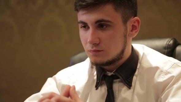 Thumbnail for Brunette Man In White Shirt Playing Poker