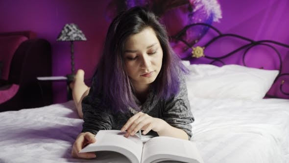 Thumbnail for Teenage Asian Girl Reading On Bed