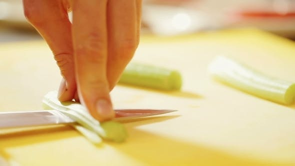 Thumbnail for Cutting Vegetables In Kitchen.