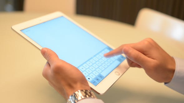 Thumbnail for Businessman Holding Tablet In Hand And Typing