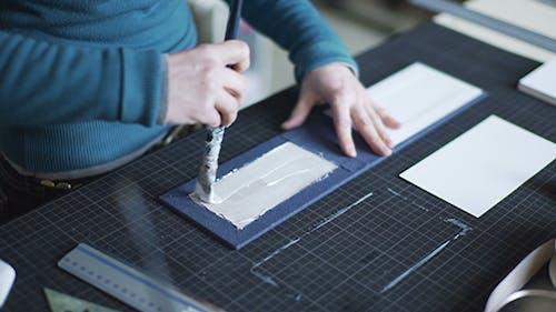 Handcraft Author Applying Glue