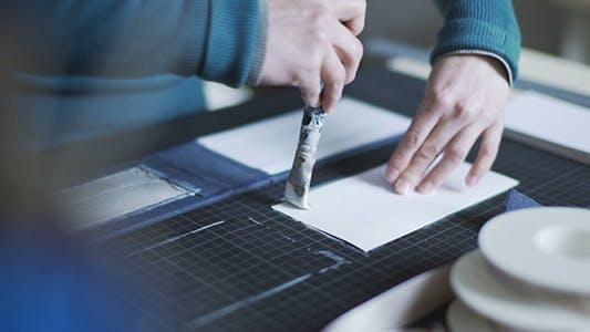Thumbnail for Handcraft Artist Applying Glue