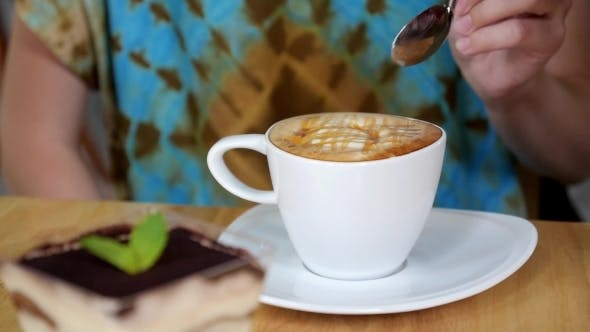 Thumbnail for Woman Drinking a Cup Of Cappuccino Coffee With Thick Froth
