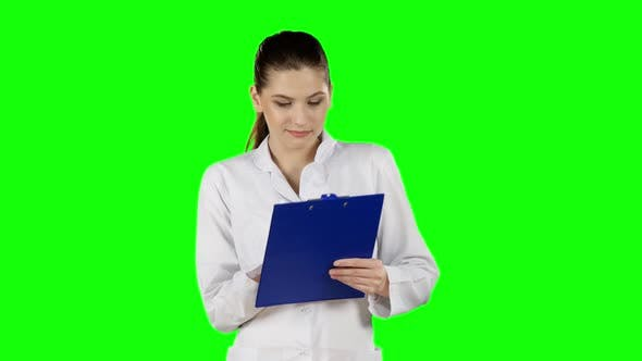 Thumbnail for Health Worker Takes Notes on Clipboard. Green Screen