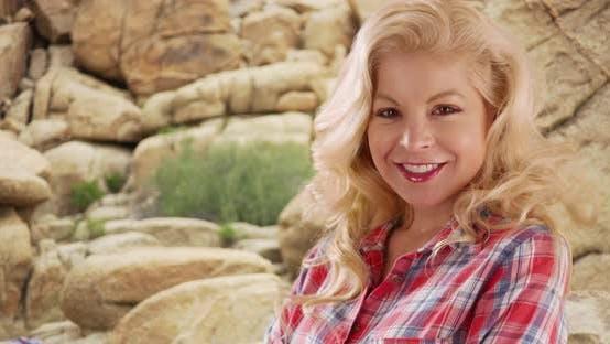 Thumbnail for Close up of cheerful woman visiting Joshua Tree National Park smiling at camera