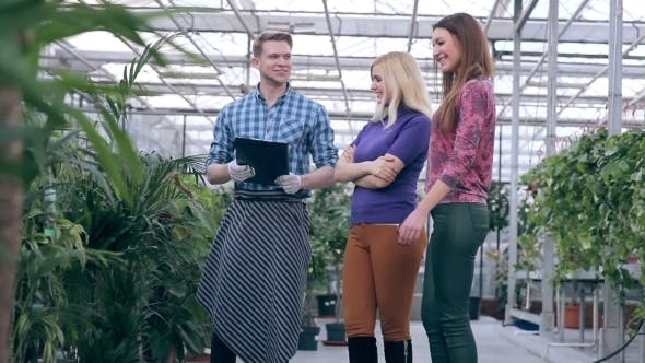 Thumbnail for Young Florist Serving Customers In Greenhouse