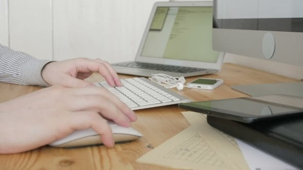 Thumbnail for Freelancer Typing On Keyboard in Modern Office, Close Up