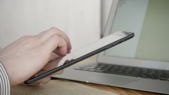 Thumbnail for Freelancer Typing On Tablet PC in Modern Office, Close Up