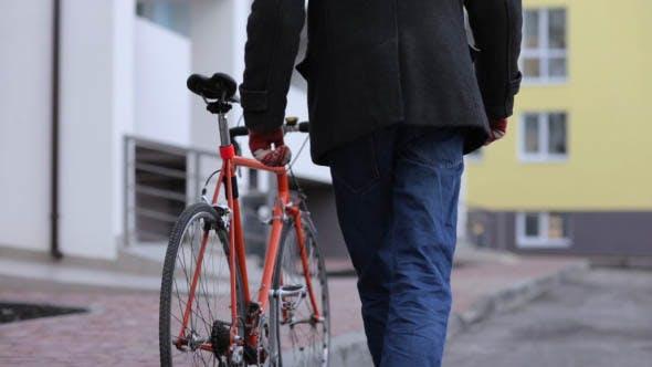 Hipster Riding a Bike