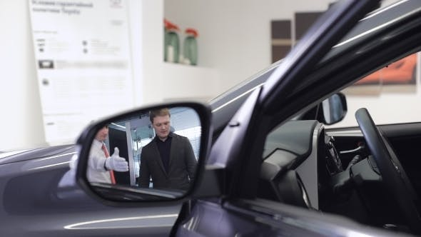 Thumbnail for Image Of Car Dealer With Client Preparing To Test Drive