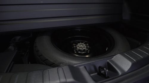 Spare Tire In The Trunk Of a Modern Car.