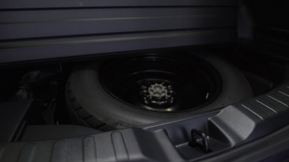 Thumbnail for Spare Tire In The Trunk Of a Modern Car.