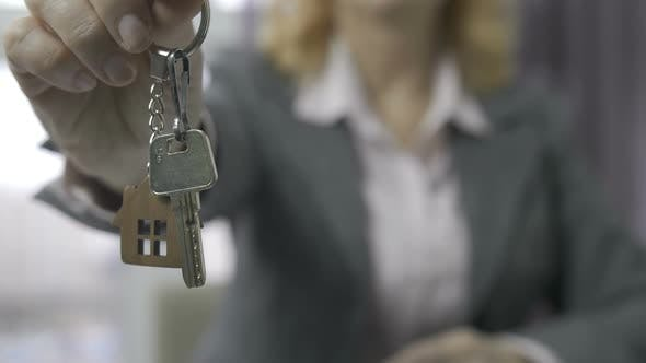 Thumbnail for Senior Estate Agent Midsection Showing House Keys