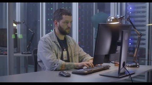 Programmer Working in Data Center