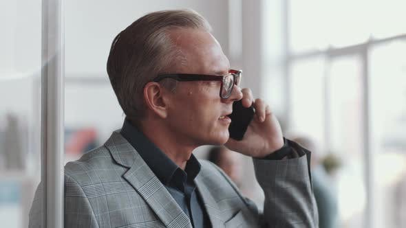 Thumbnail for Professional Businessman Talking on Cell Phone in Office