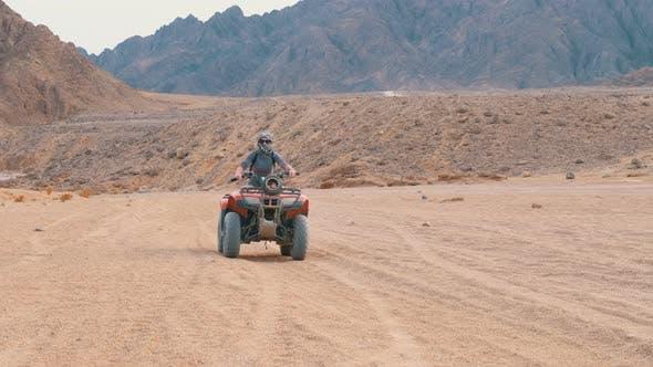 Thumbnail for Girl on a Quad Bike Rides Through the Desert of Egypt