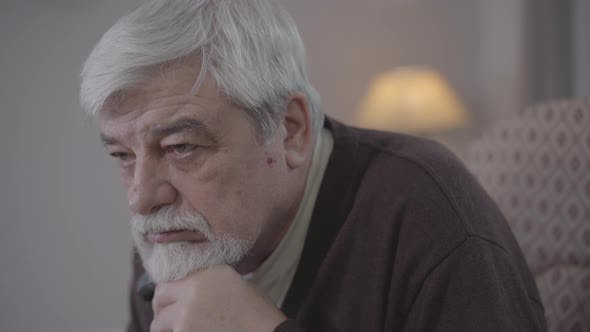 Thumbnail for Side View Close-up of Desperate Caucasian Old Man Sighing. Portrait of Brown-eyed Grey-haired