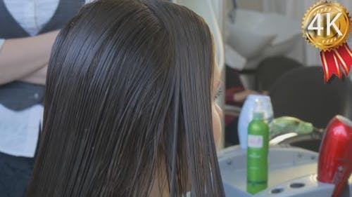 Stylist Hairdresser is Combing Hair