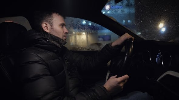 Thumbnail for Man Driving His Modern Car at Night in a City