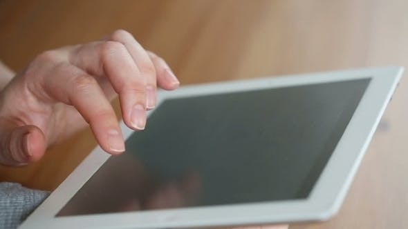 Thumbnail for A Hand Touching Tablet Computer Surface Touchscreen