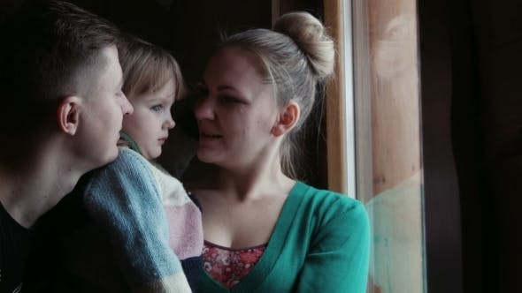 Thumbnail for Family Behind Window Look At The Snowy Mountains
