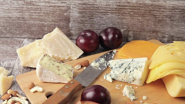 Thumbnail for Different Type Of Cheese On Wooden Background