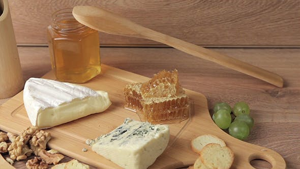 Thumbnail for French Cheese And Honey On Wooden Background