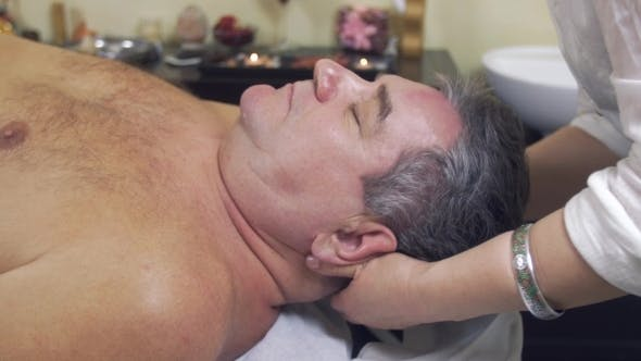 Thumbnail for Masseuse Hands Make Healing Massage Of Head To Adult Fat Man.