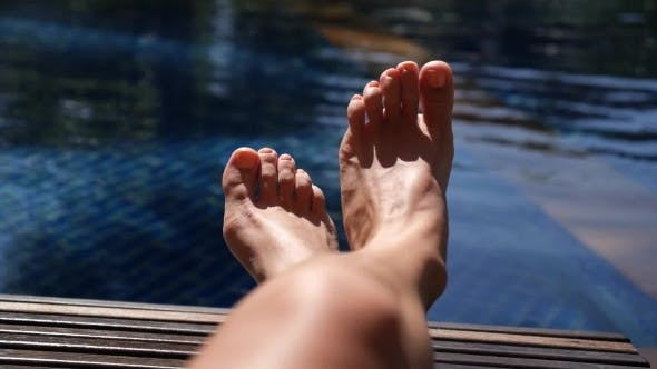 Thumbnail for Cheerful Feet Of Woman Near Swimming Pool On Vacation