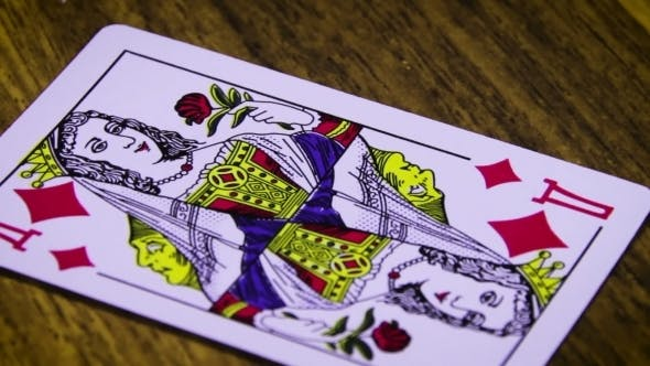 Thumbnail for Playing Card Rotates On a Wooden Table