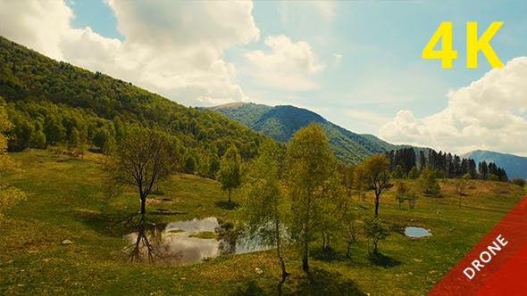 Thumbnail for Aerial View of a Beautiful Valley and Mountains in a Sunny Day