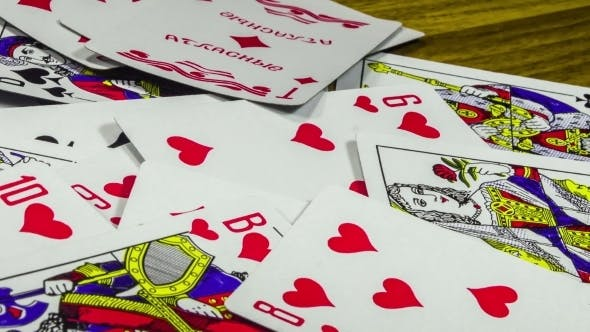 Thumbnail for Playing Cards Moving And Rotate On a Wooden Table