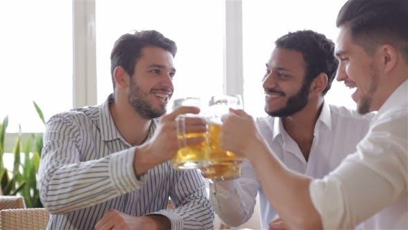 Thumbnail for Three Cheerful Men Toasting