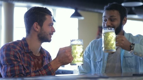 Thumbnail for Two Happy Football Fans At The Bar