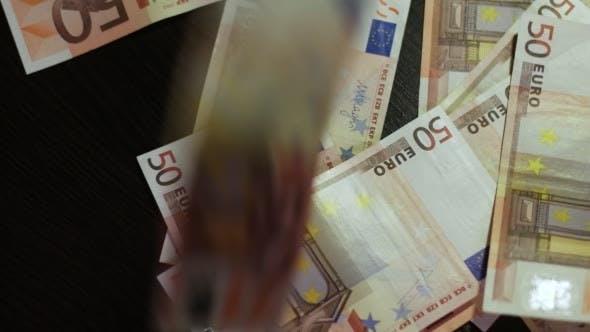 Thumbnail for Counting Euros. Euro Banknotes Falling Down
