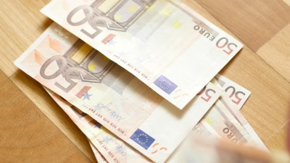 Thumbnail for Close Shot of Hands Counting Euro Money Bills