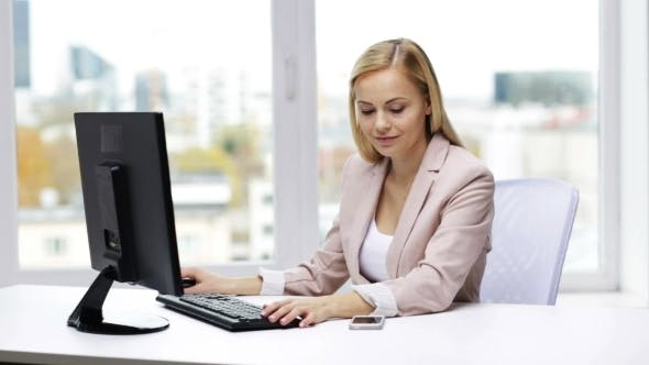 Thumbnail for Smiling Businesswoman With Computer And Smartphone