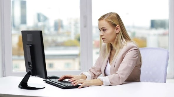 Thumbnail for Young Businesswoman With Computer Typing At Office